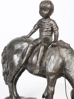 Boy riding Pony image 2